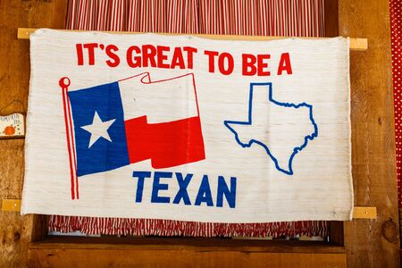 Colorful Texas pride sign with flag and state outline.