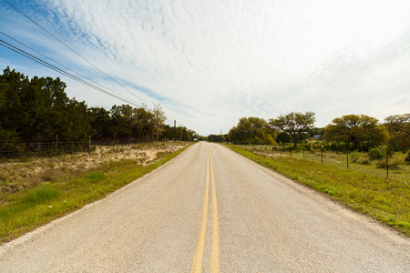 country roads: Long winding road with ranches in the Texas Hill Country. Stock Photo
