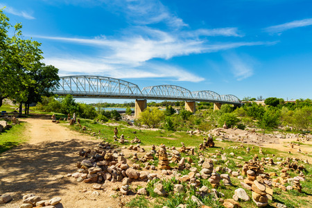 small country town: The rustic Highway 71 bridge over the Llano River in the small Texas Hill Country town of LLano.