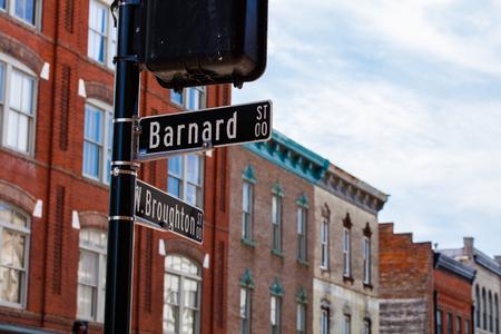 destination scenics: Downtown Savannah, Georgia cityscape with street signs.