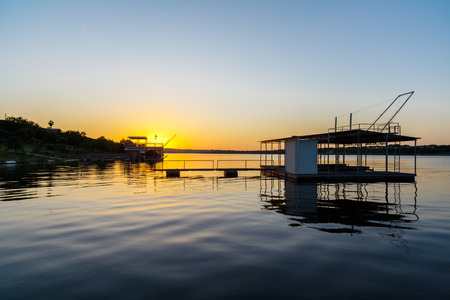 boathouse: Sunset view of an empty boathouse on popular Lake Travis in Austin, Texas.