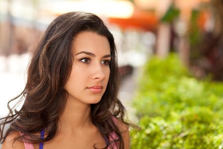 southern european: Beautiful young woman outdoors Stock Photo