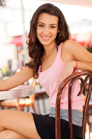 south american ethnicity: Beautiful young woman in a outdoor restaurant