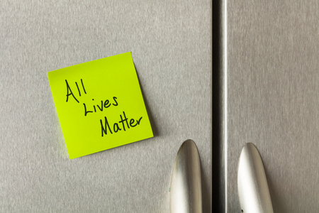 commentary: Social commentary on a sticky note on a home refrigerator.