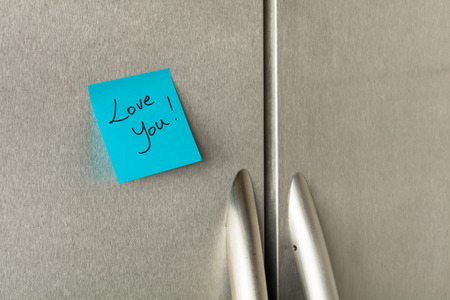 appliance: Love you sticky note on a home refrigerator.