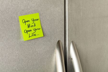 refrigerator: Wisdom saying sticky note on a home refrigerator.
