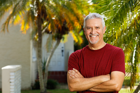 Handsome middle age man outdoor portrait.