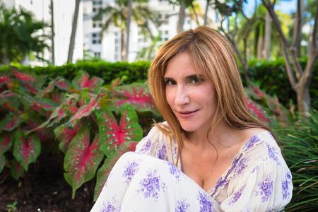 fair complexion: Pretty woman in a outdoor setting.