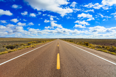 country roads: Rural two lane highway in the Arizona desert. Stock Photo