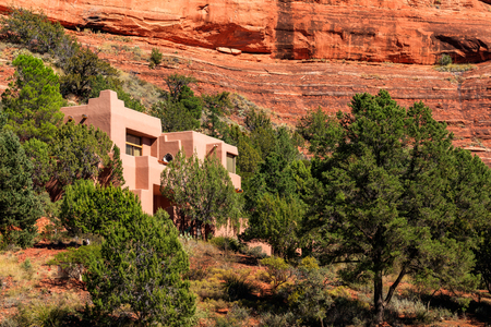 Beautiful adobe style residence in the natural beauty of the red rock canyons and sandstone of Sedona in Arizona.