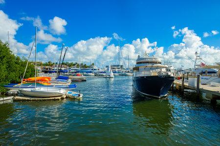 barca da pesca: Coconut Grove, FL USA - December 24, 2016: Boats docked in a crowded marina in Coconut Grove in Miami. Editoriali