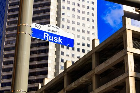 rusk: Rusk street sign in downtown Houston, Texas with a skyscraper in the background. Stock Photo