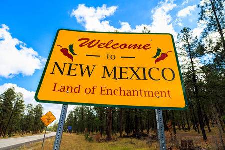 enchantment: Welcome to New Mexico sign along the roadside.