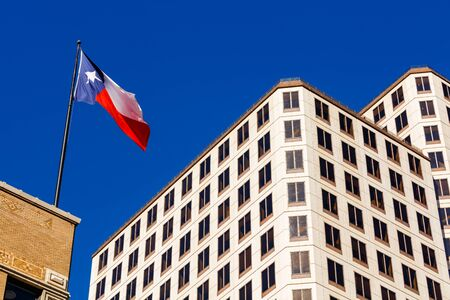 Austin, Texas cityscape view with state flag in the historic district.