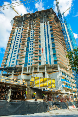 completion: Miami, FL USA - December 12, 2016: New hi rise condominium building construction project nearing completion in the popular midtown area.