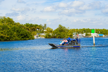 Everglades City, FL USA - January 26, 2017: The small coastal town in the Everglades is a popular tourist destination with airboat rides along the Barron River.