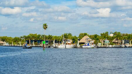 everglades: Everglades City, FL USA - January 26, 2017: The small coastal town in the Everglades is a popular tourist destination with airboat rides along the Barron River.
