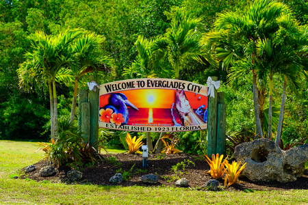 Everglades City, FL USA - January 26, 2017: Colorful welcome sign to the small rural city located in the Florida Everglades.