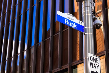 Rusk street sign in downtown Houston, Texas with a skyscraper in the background. Stock Photo