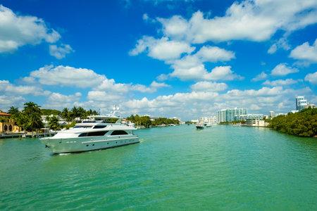 cruising: Miami Beach, FL USA - February 13, 2017: Luxury yachts cruising along the intracoastal waterway for display at the popular Miami International Boat Show.