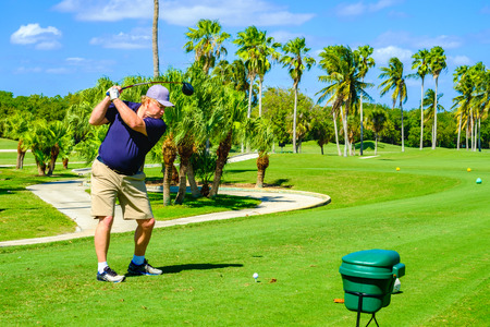 golfcourse: Key Biscayne, FL USA - February 10, 2017: Unidentified golfer teeing off in the beautiful public Crandon Golf along Biscayne Bay. Editorial