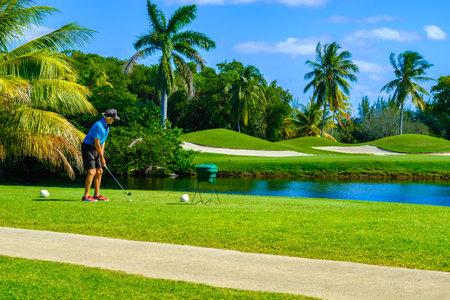 Key Biscayne, FL USA - February 10, 2017: Unidentified golfer teeing off in the beautiful public Crandon Golf along Biscayne Bay. Editorial