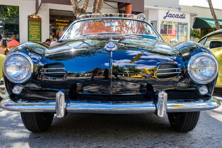 Miami, FL USA - February 12, 2017: Close up view of the front end of a vintage Volkswagen Karmann Ghia automobile.