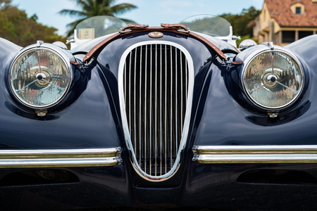 Miami, FL USA - March 12, 2017: Close up view of the front end of a beautifully restored vintage 1951 British Jaguar XK120 convertible automobile at a public car show along Palmetto Bay in Miami.