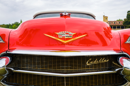 Miami, FL USA - March 12, 2017: Close up view of the front end of a beautifully restored vintage 1956 Cadillac Series 62 convertible automobile at a public car show along Palmetto Bay in Miami.