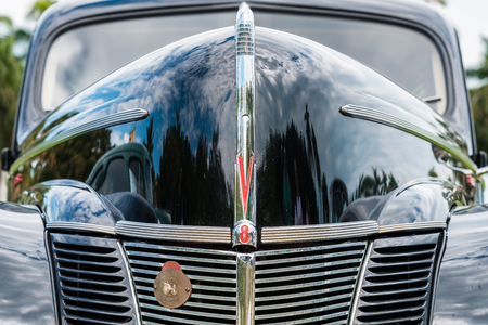 Miami, FL USA - March 12, 2017: Close up view of the front end of a beautifully restored vintage 1940 Ford Tudor automobile at a public car show along Palmetto Bay in Miami. Editorial