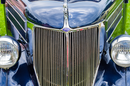 Miami, FL USA - March 12, 2017: Close up view of the front end of a beautifully restored vintage 1936 Ford Cabriolet automobile at a public car show along Palmetto Bay in Miami.