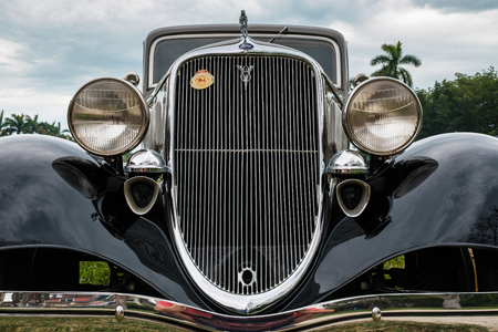 grille: Miami, FL USA - March 12, 2017: Close up view of the front end of a beautifully restored vintage 1933 Ford 2 door sedan automobile at a public car show along Palmetto Bay in Miami. Editorial