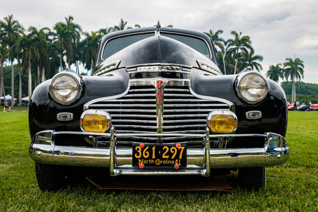 grille: Miami, FL USA - March 12, 2017: Close up view of the front end of a beautifully restored vintage 1941 Chevy Special Deluxe automobile at a public car show along Palmetto Bay in Miami.