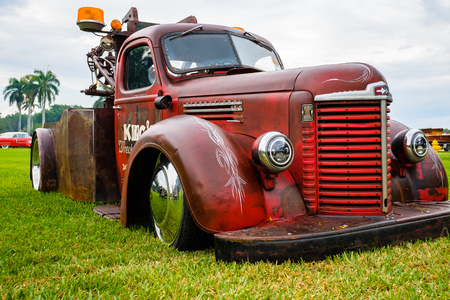 Miami, FL USA - March 12, 2017: Close up view of the front end of a beautifully restored vintage 1947 International tow truck automobile at a public car show along Palmetto Bay in Miami.