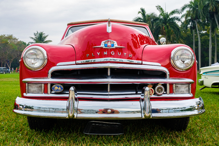 Miami, FL USA - March 12, 2017: Close up view of the front end of a beautifully restored vintage 1950 Plymouth Special Deluxe automobile at a public car show along Palmetto Bay in Miami. Editorial