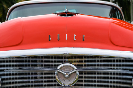 Miami, FL USA - March 12, 2017: Close up view of the front end of a beautifully restored vintage 1955 Buick Special automobile at a public car show along Palmetto Bay in Miami.
