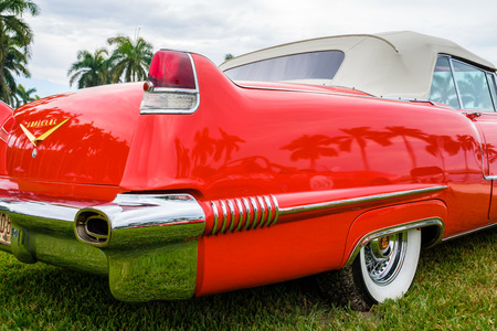 Miami, FL USA - March 12, 2017: Close up view of the rear end of a beautifully restored vintage 1956 Cadillac Series 62 convertible automobile at a public car show along Palmetto Bay in Miami.