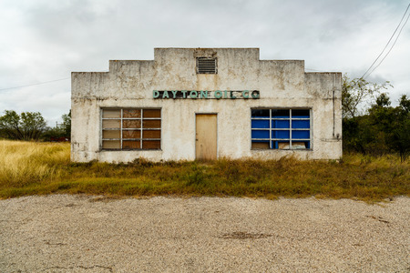 run down: Silver City, New Mexico USA - November 6, 2016: A vacant and vintage Dayton Oil Company building in a dilapidated state in this small town on rural Highway 180. Editorial