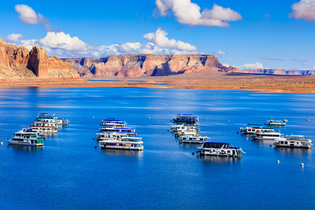 Lake Powell, UT USA - October 25, 2016: The beauty of Lake Powell in Utah with houseboats and canyons in the background. Editorial