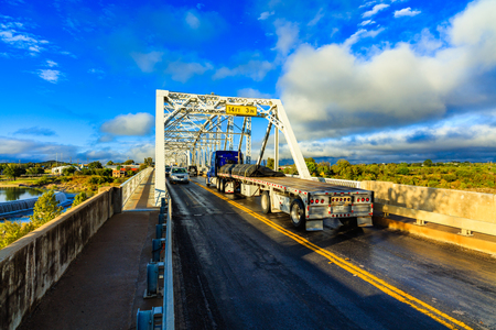 Llano, Texas USA - November 6, 2016: The historic Llano River Bridge is a busy crossing on Highway 71 through this small hill country town.