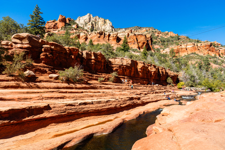 Coconino, AZ USA - October 17, 2016: Visitors enjoying the beauty of Slide Rock State Park with its natural rock water slides in the Oak Creek Canyon near Sedona. Editorial