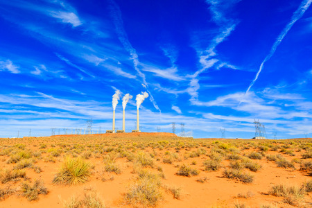 Desert landscape in Arizona with a power plant in the background. Stock Photo