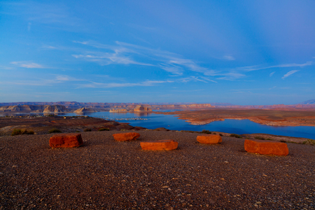 Panoramic view of the beautiful blue Lake Powell on the Arizona and Utah border at sunset.