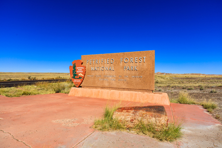 northeastern: Navajo County, AZ USA - October 19, 2016: The entrance sign to the Petrified Forest National Park, a popular tourist destination in northeastern Arizona. Editorial