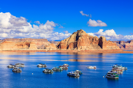 Lake Powell, UT USA - October 25, 2016: The beauty of Lake Powell in Utah with houseboats and canyons in the background. Editöryel