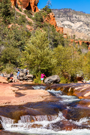 sonoran: Coconino, AZ USA - October 17, 2016: Visitors enjoying the beauty of Slide Rock State Park with its natural rock water slides in the Oak Creek Canyon near Sedona. Editorial