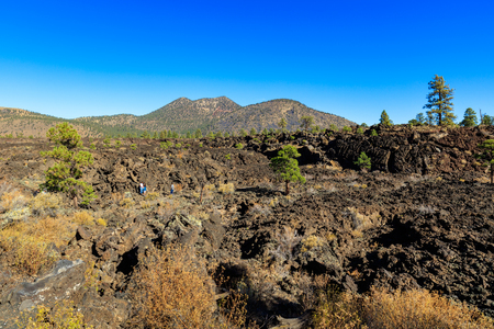 flagstaff: Flagstaff, AZ USA - October 15, 2016: Visitors enjoying the natural beauty of the crystallized lava flow at the Sunset Crater Volcano.