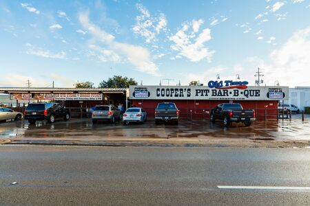 old time: Llano, Texas USA - November 6, 2016: Coopers Old Time Pit Bar-B-Que on Dallas Street is a popular smokehouse restaurant in this small hill country town.