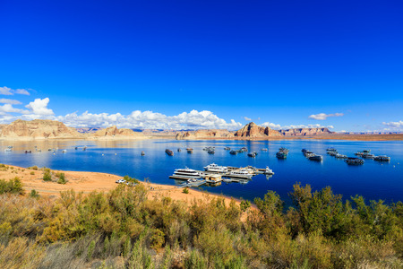 ut: Lake Powell, UT USA - October 25, 2016: The beauty of Lake Powell in Utah with houseboats and canyons in the background. Editorial