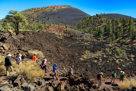 Flagstaff, AZ USA - October 15, 2016: Visitors enjoying the natural beauty of the crystallized lava flow at the Sunset Crater Volcano.